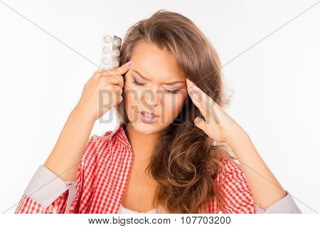 Girl Holding Tablets And Suffering From Strong Headache