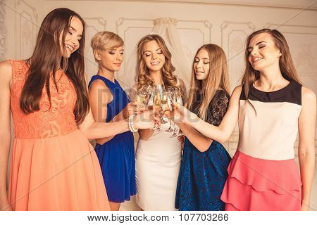 Cute Young Women Celebrating Hen Party With Sparkling Wine
