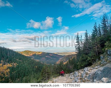 Two hikers going up the Alpine trail in the High Tatra, Poland