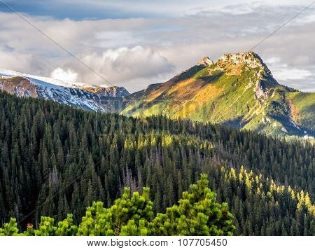 Mount Giewont in beautiful autumn colors seen from the alpine trail in the Tatra mountains, Poland