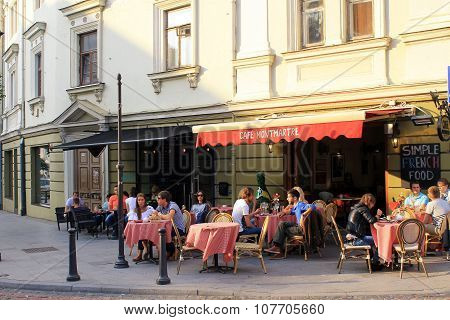 People Relax At Outdoor Cafe Montmartre In The Old Town, Vilnius, Lithuania.