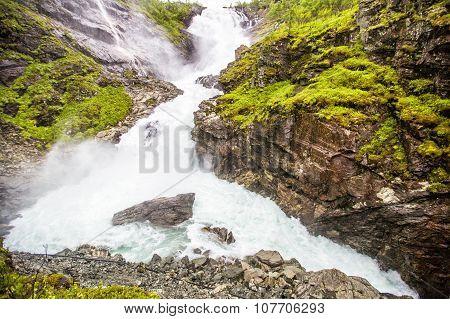 Kjosfossen Waterfall In Flam, Norway.