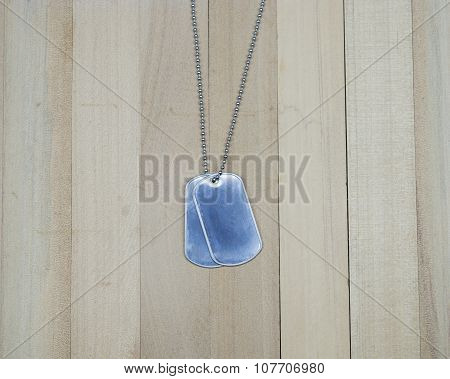 Military Dog Tags On Wood Background