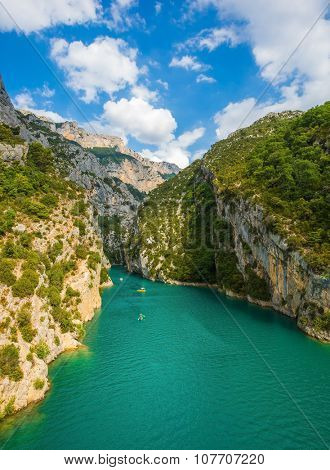 National park Merkantur, France. White catamarans and motor boats are sailing with tourists on turquoise water of the river Verdon