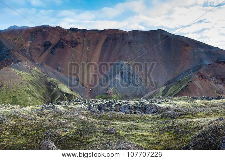 The picturesque valley surrounded by rhyolite mountains. Summer morning in the National Park Landmannalaugar, Iceland