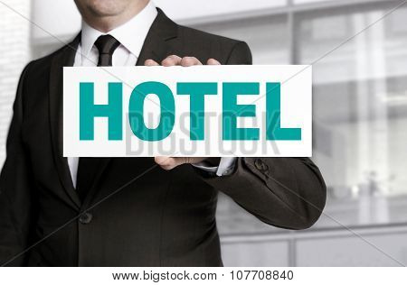 Hotel Sign Is Held By Businessman Concept