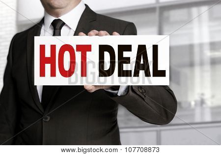 Hot Deal Sign Is Held By Businessman Concept