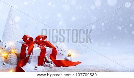 Art Christmas Balls And Gift Box On Snow