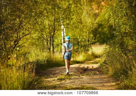 Girl In A Hat Walks Through The Birch Forest