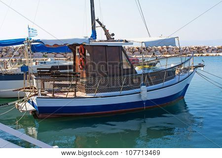 Small wooden ship in a port