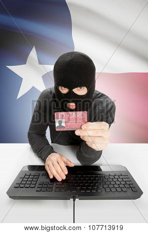 Hacker With Usa States Flag On Background And Id Card In Hand - Texas