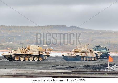Armoured recovery vehicle BREM-1M evacuates tank