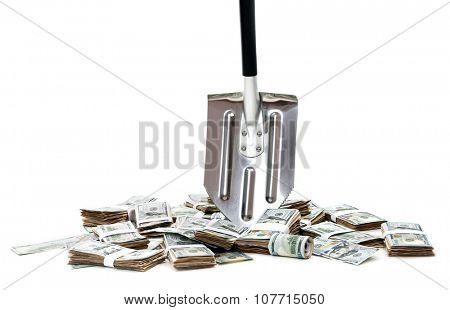 Shovel lifts dollar bills on white background