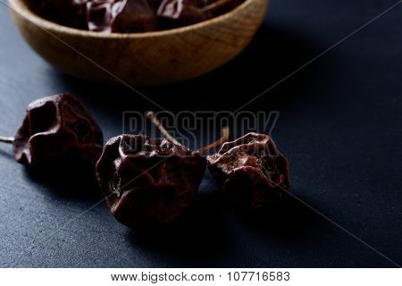 Dried Pears In A Wooden Bowl On Slate
