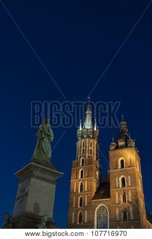 Poland, Krakow, Mickiewicz Monument, St Mary Curch Towers, Dusk