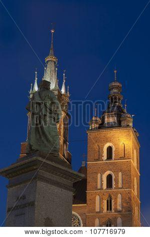 Poland, Krakow, Mickiewicz Monument, St Marycurch Towers, Dusk