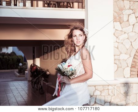 portrait of beatiful bride posing with a bouquet