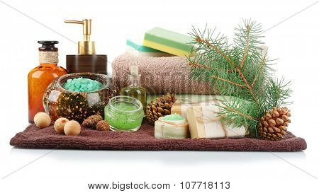 Essential oil of pine, handmade soap and cream with pine extracts and spa treatments, isolated on white