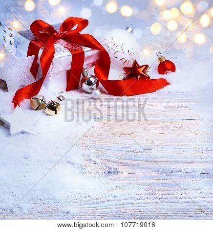 Art Christmas Tree Light; Festive Background With Christmas Balls And Gift Box On Snow
