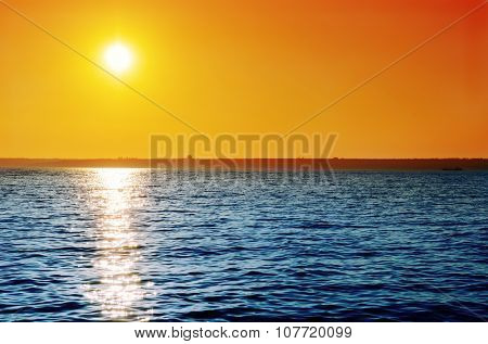 orange sky on sunset over blue water