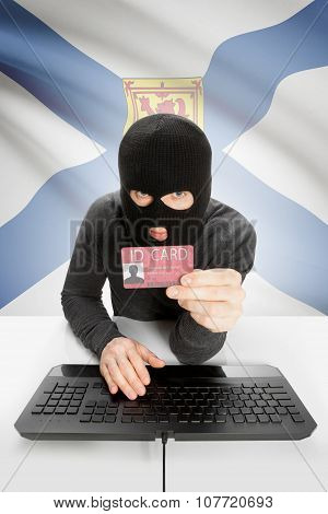 Hacker With Canadian Province Flag On Background Holding Id Card In Hand - Nova Scotia