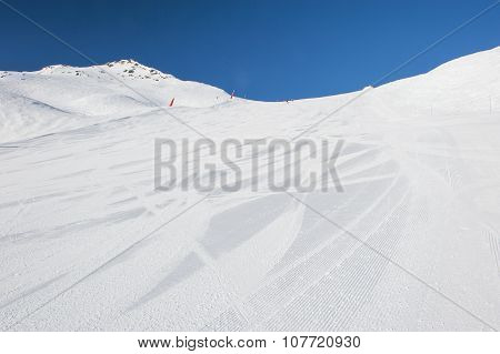 Snowy Ski Piste On A Mountain