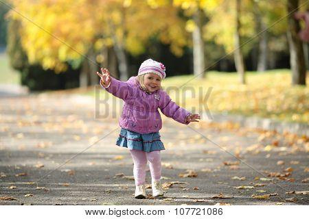 The happy girl walks on park