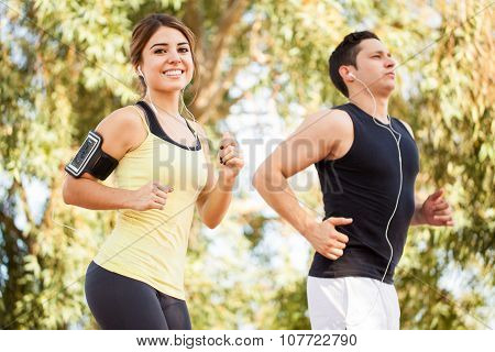 Couple Running And Listening To Music