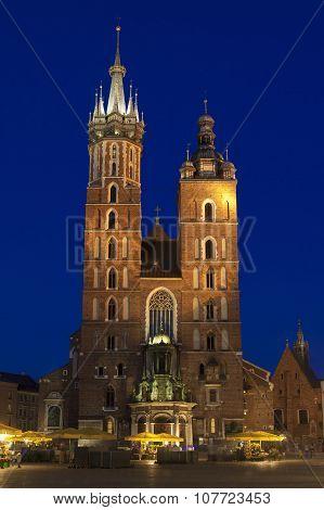 Poland, Krakow, Mariacki Church Facade Lit Up At Dusk