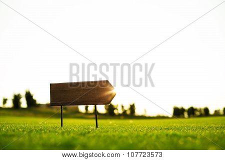 Signboard On A Golf Field, Sunset Shot