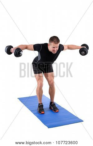 Young man shows finishing position of Standing Bent Over Dumbbell Reverse Fly workout, isolated on white