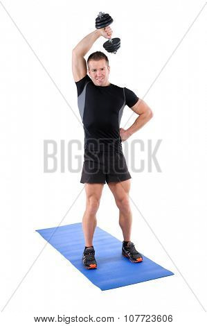 Young man shows finishing position of Standing Triceps Extension Dumbbell  behind head workout, isolated on white