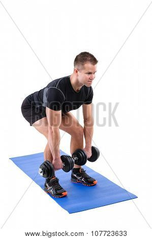 Young man shows finishing position of Squats with dumbbels workout, isolated on white