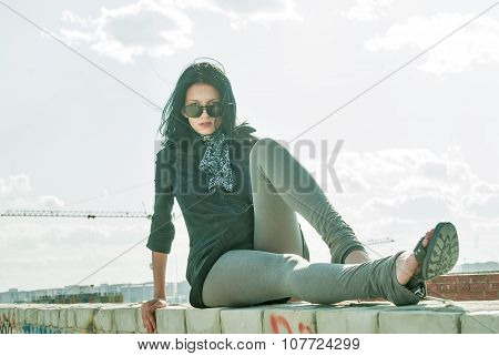 Young pretty woman on roof