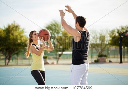 Pretty Couple Shooting Some Hoops