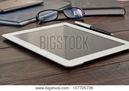 White Tablet Computer With Office Objects