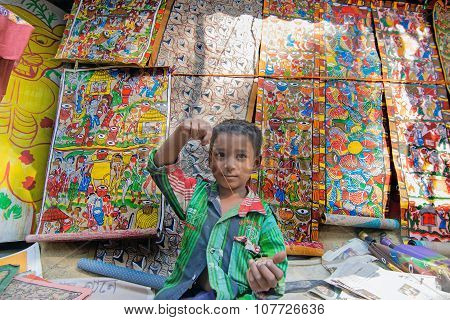 Rural Child Playing And Selling Handicrafts In Pingla Village, West Bengal, India