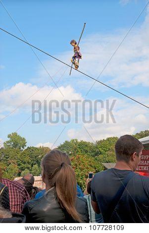 Saint-Petersburg. Russia. Uzbek girl walking on a tightrope