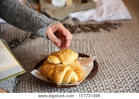 Girl with light breakfast on bed
