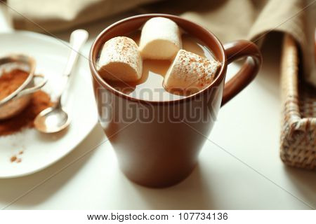 Cup of coffee with marsh mellow on a table