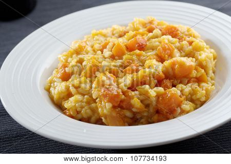 Pumpkin risotto in a bowl closeup