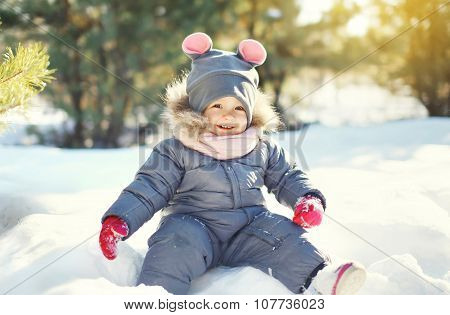 Happy Smiling Little Child Playing On Snow In Winter Day