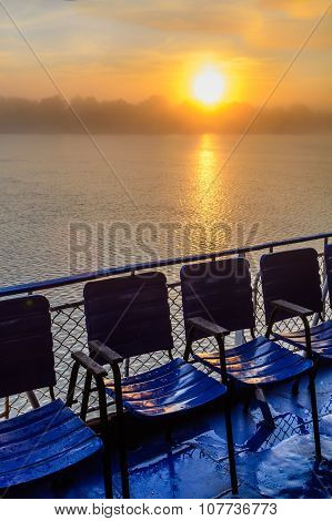 Landscape Of Sunset From An Observation Platform With Chairs. Beautiful View Of Colorful Sunset On T