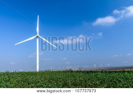 Wind Turbine On The Meadow On Background Of Skies. Colorful Picture Of Wind Turbine Generating Enegr