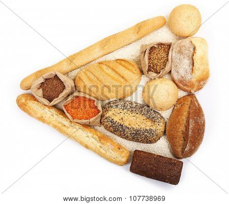 Composition of mixed breads and grains isolated on white background
