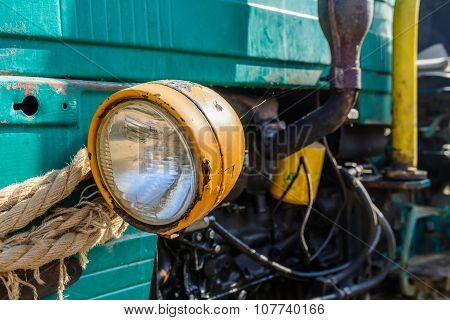 Headlight Of Old Vehicle Closeup. Colorful Background Of Aged Retro Equipment In The Village.  .