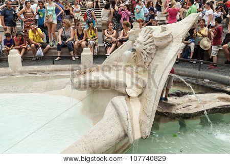 Tourists Relax Near Fontana Della Barcaccia
