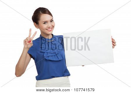 Young Asian Woman Show Victory Sign With Blank Sign