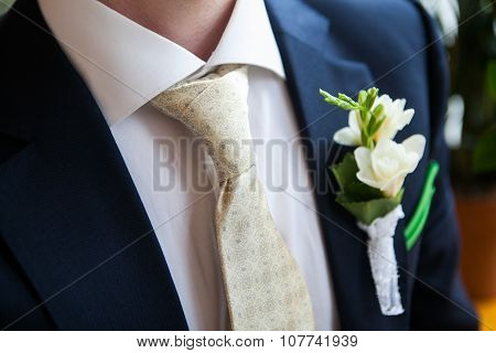 Boutonniere On The Lapel Of The Groom