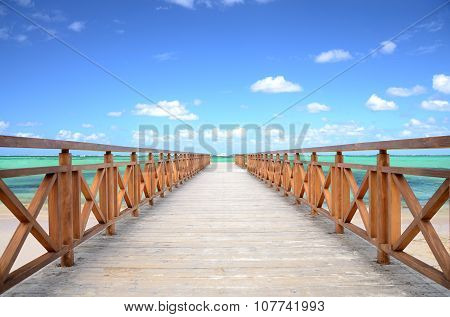 Caribbean Jetty And Exotic Beach